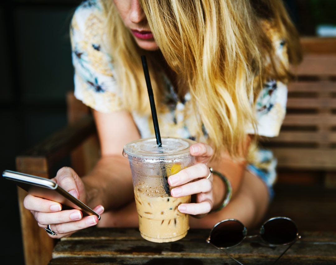 Woman Drinking Coffee on Phone